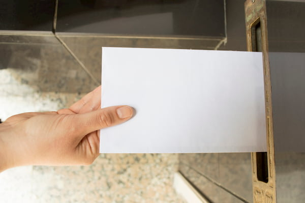 Letter Being Posted Through Letterbox Using Direct Mailing Services